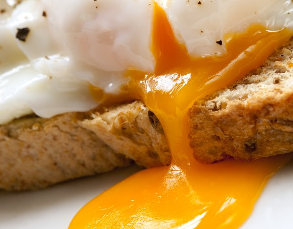Poached eggs on toast, garnished with parsley.